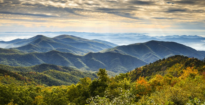 Ride along beautiful mountain ranges on a Trek Travel bike tour from Asheville to Highlands