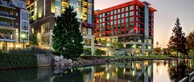 Stay at the Hampton Inn & Suites by Hilton Greenville Downtown RiverPlace on a Trek Travel Greenville Ride Camp