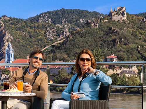 Relax with extraordinary views on our river cruise bike tour