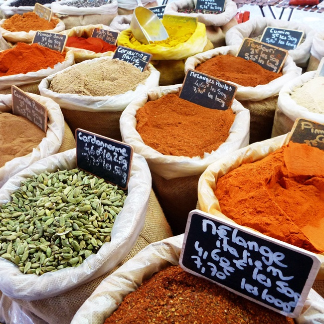Shop for local food at a traditional French market